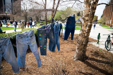 Denim Jeans are decorated and hung by the Raynor Memorial Library to honor Denim Day. Marquette Wire stock photo