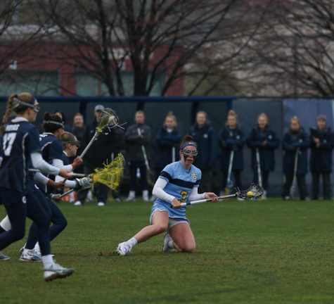 Going from four sports to one lightens workload for two WLAX players