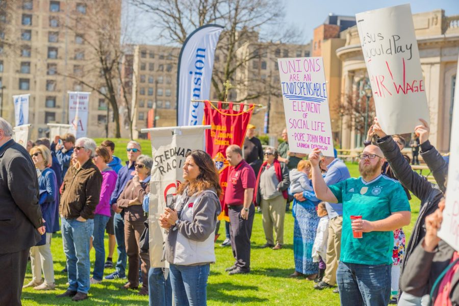 Unionization supporters approach President Lovell at 175th Archdiocese celebration