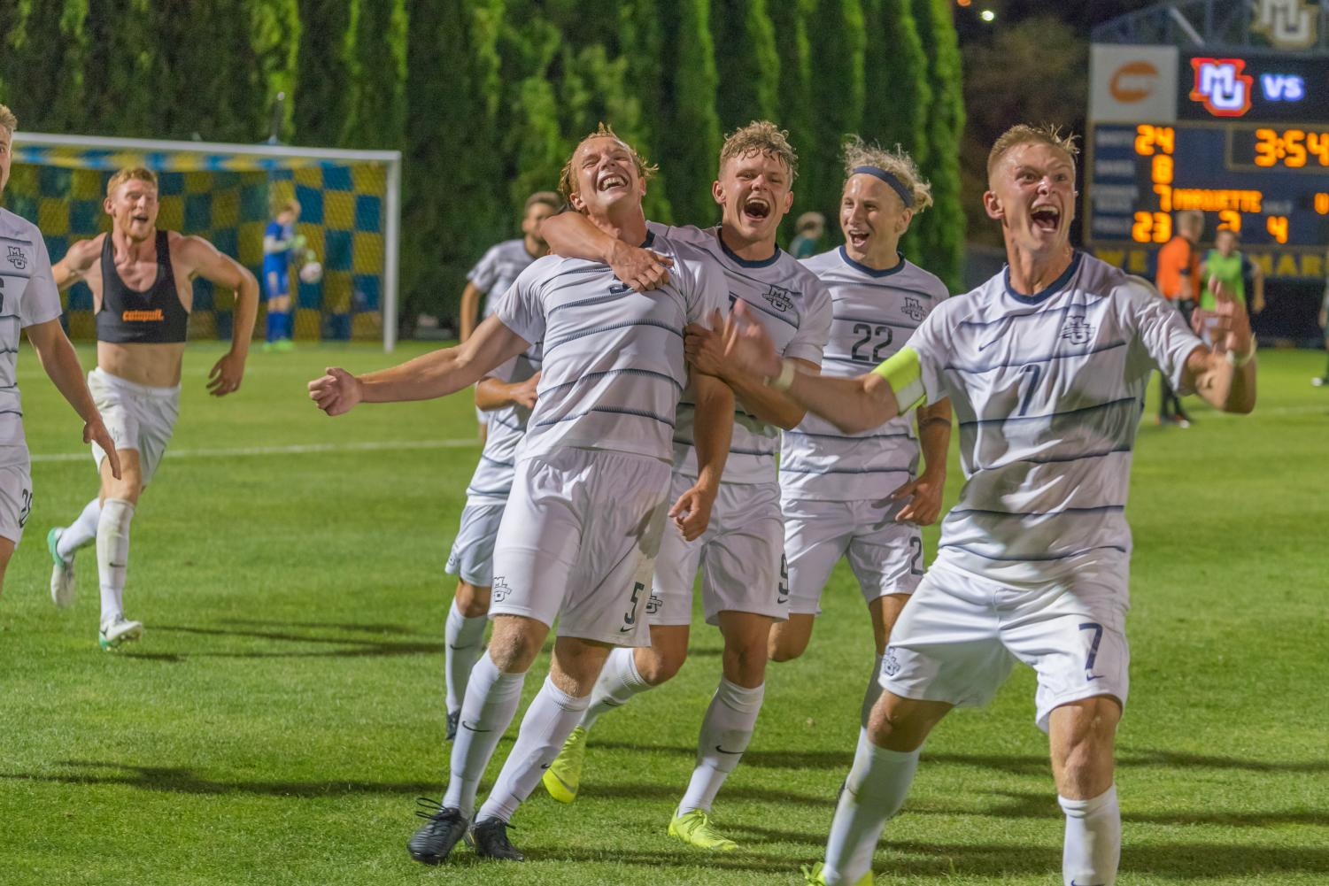 Marquette men's soccer celebrates after Manuel Cukaj's game-winning goal Friday night against UAB.