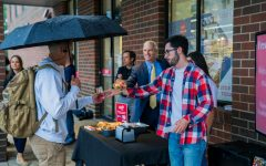 President Lovell hands out free breakfast sandwiches at Sendiks Fresh2GO on the first day of classes