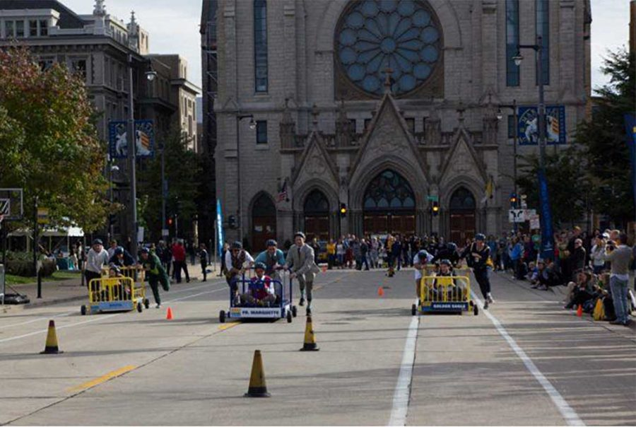 Teams race down lanes separated by cones from one end of 12th Street to the other. Marquette Wire stock photo.