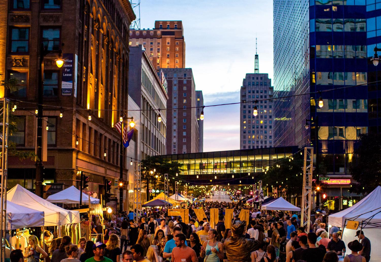 The monthly market brings attendees and performers alike to the heart of Milwaukee. Photo courtesy of NEWaukee.