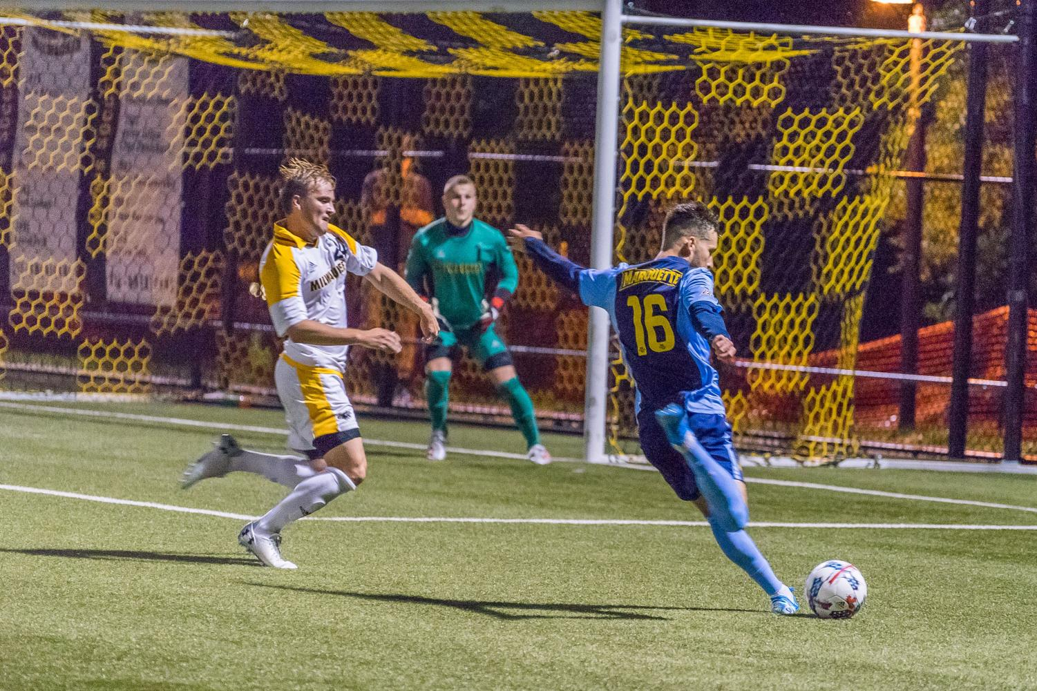 Marquette's Josh Coan (16) attempts a goal in the Golden Eagles' loss to UWM at Engelmann Stadium.
