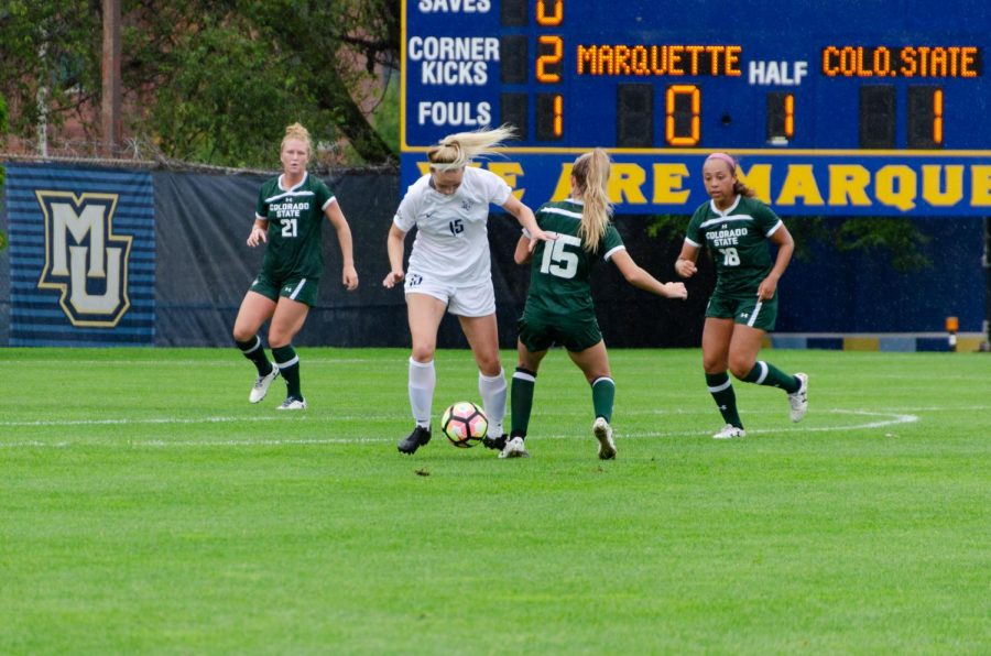 Alyssa Bombacino (15) looks to get the ball past a pair of Colorado State defenders Sept. 22 at Valley Fields.