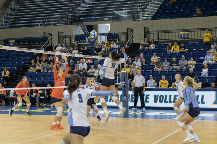 Gwyn Jones attempts a kill against Syracuse at the Al McGuire Center Sept. 7.