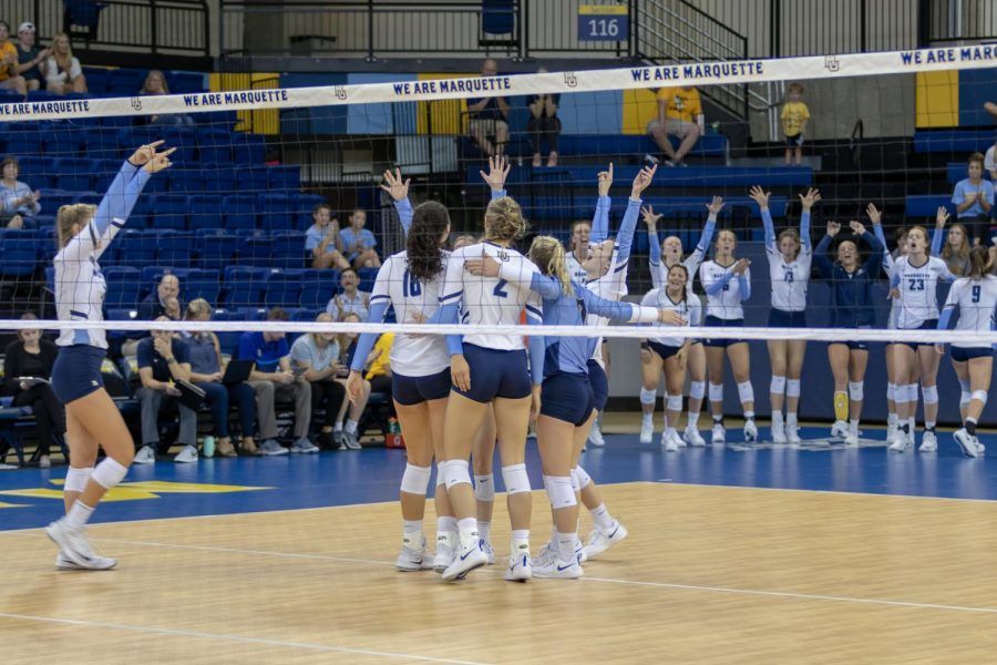 Marquette celebrates a point in its win against Syracuse Sept. 7.