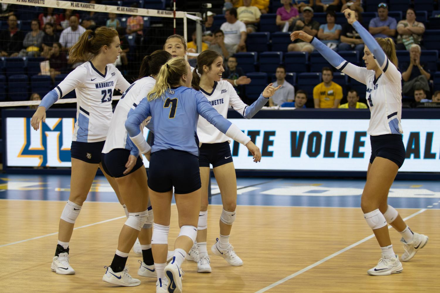 Marquette celebrates a point in its win against Syracuse Sept. 7 at the Al McGuire Center.