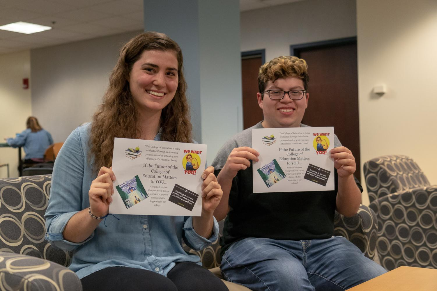Brooke McArdle and Jonathon Jimenez hold fliers they created for an event this Friday to talk about the future of the College of Education.
