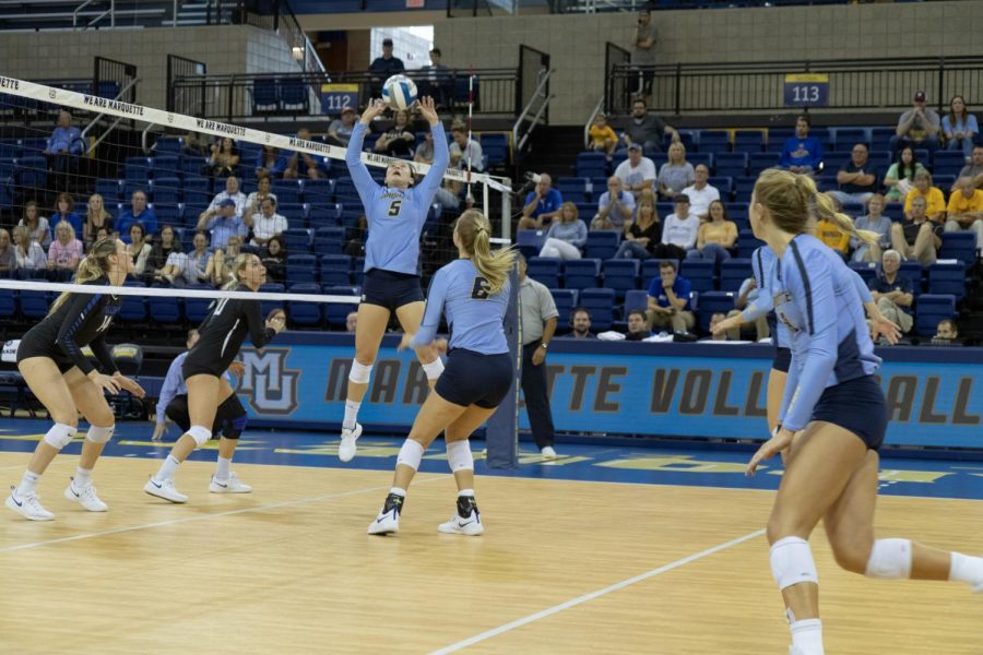 Senior setter Lauren Speckman sets the ball in Marquette's three-set sweep against Saint Louis University Sept. 21.
