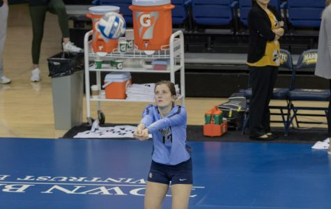 Katie Schoessow goes to hit a ball during warmups before Marquette' sweep over Saint Louis University Saturday morning.