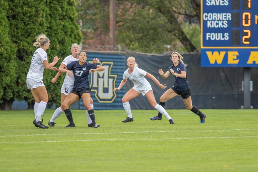 Madison Burrier (13) fights for the ball with Utah State in the first game she started in the 2019 season.