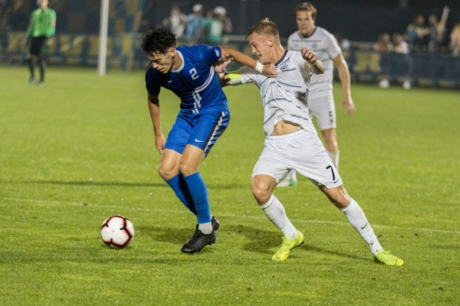 Patrick Seagrist (7) fights for the ball in Marquette's 1-0 loss to Creighton.