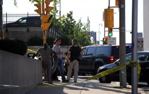 Police work to gather information on the scene near 9th and Wells streets after Tuesday's shooting.