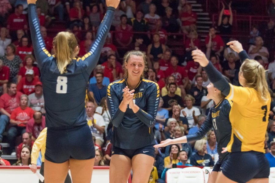No. 11 Marquette volleyball celebrates a point in its five-set win over No. 4 Wisconsin.