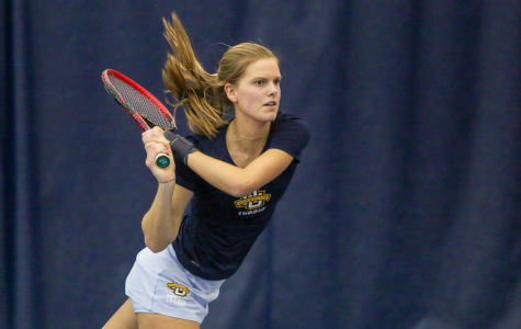 Senior Fleur Eggink hitting a backhand. Photo courtesy of Marquette Athletics.)