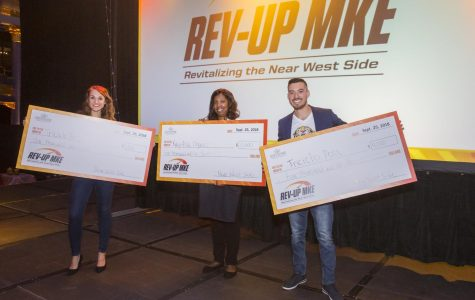 The 2018 finalists of Rev Up MKE hold their checks.