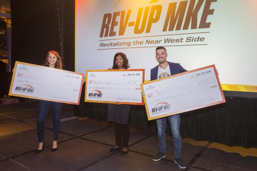 The+2018+finalists+of+Rev+Up+MKE+hold+their+checks.