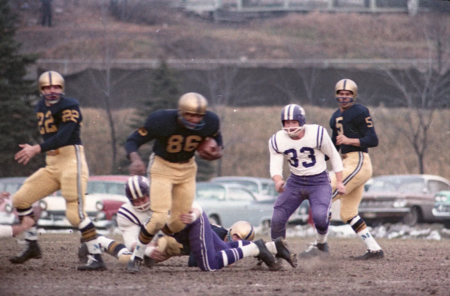 Marquette University football team beats Holy Cross 30-12 Nov. 21, 1959. Photo courtesy of Milwaukee Journal Sentinel.