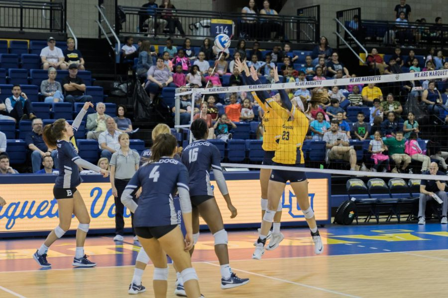 Elizabeth Orf and Hope Werch go for a block in Marquette's win over Butler Wednesday.