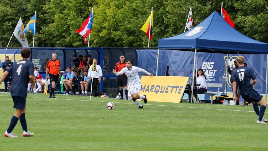 Louis Yuill runs toward the ball in Marquette's 0-0 tie against UC Davis. (Photo courtesy of Marquette Athletics.)