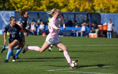 Alyssa Bombacino kicks one of her three goals in Marquette's 3-1 win over Villanova Oct. 20 at Valley Fields. (Photo courtesy of Marquette Athletics)