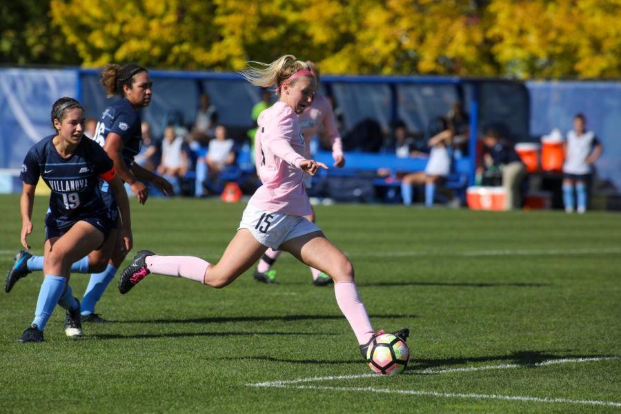 Alyssa+Bombacino+kicks+one+of+her+three+goals+in+Marquette%27s+3-1+win+over+Villanova+Oct.+20+at+Valley+Fields.+%28Photo+courtesy+of+Marquette+Athletics%29