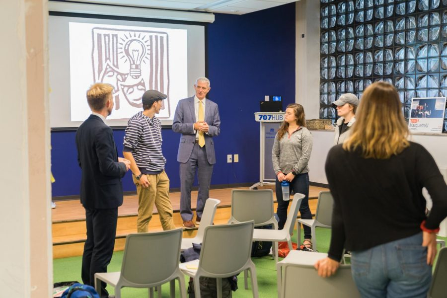 University president Michael Lovell talks with his students Monday night at the 707 Hub.