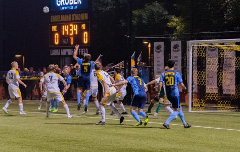 Manuel Cukaj (5) jumps attempting to win possession of the ball at UWM's Engelmann Stadium.