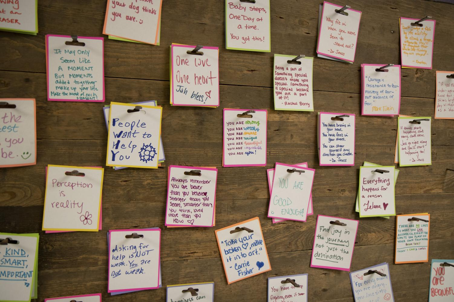 A wall of notes promote motivational sayings to keep students going.