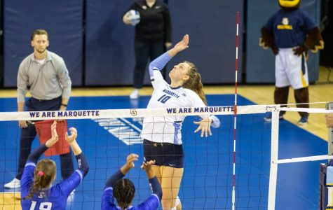 Allie Barber (10) attempts a kill in Marquette's 3-2 loss to Creighton. She led the Golden Eagles with 18 kills Friday night at Villanova.