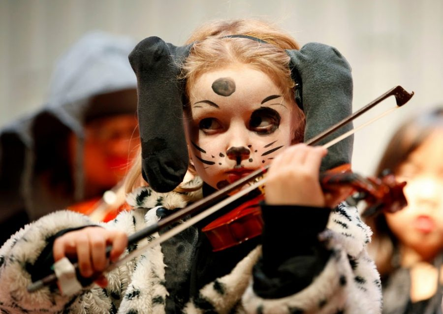 A young performer plays the violin at a past Halloween concert with the String Academy of Wisconsin. Photo courtesy of the String Academy of Wisconsin at UWM.