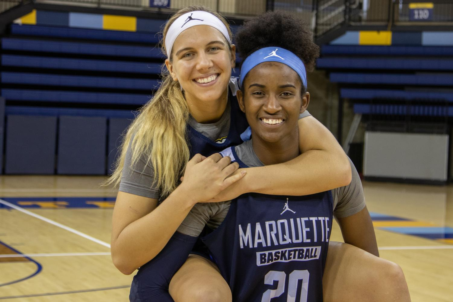 Senior forward Altia Anderson (20) and guard Isabelle Spingola (30).