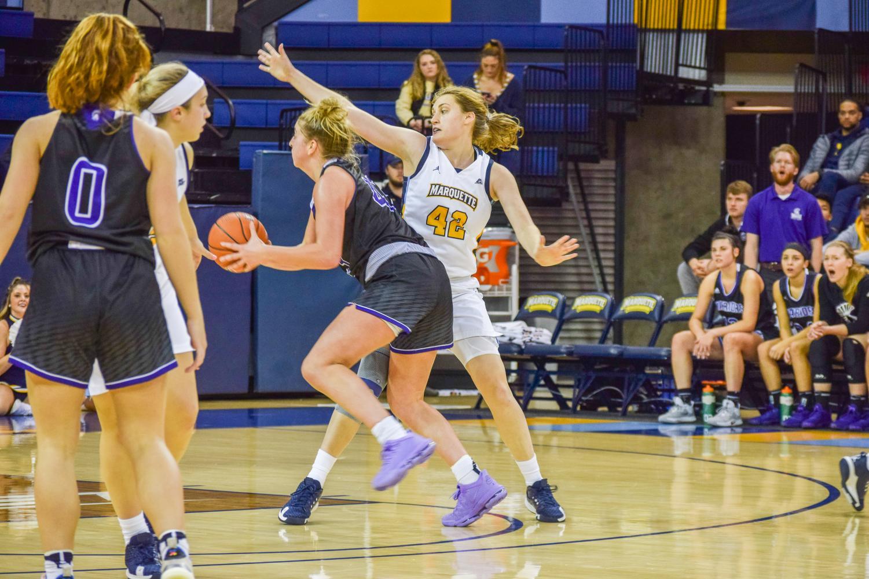 Lauren Van Kleunen defends a Winona State shot in Marquette's exhibition win Oct. 26 at the Al McGuire Center.