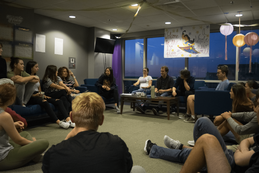Students attend a floor meeting in their decorated common area on the 13th floor of Straz Tower.