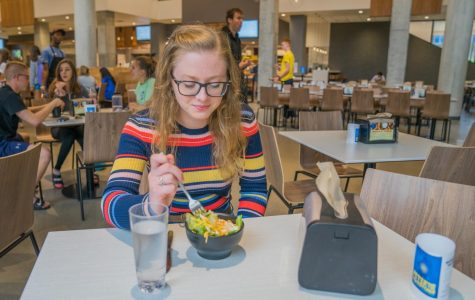 Lily Wieringa, a junior in the College of Arts & Sciences, eats a salad in The Commons' dining hall.