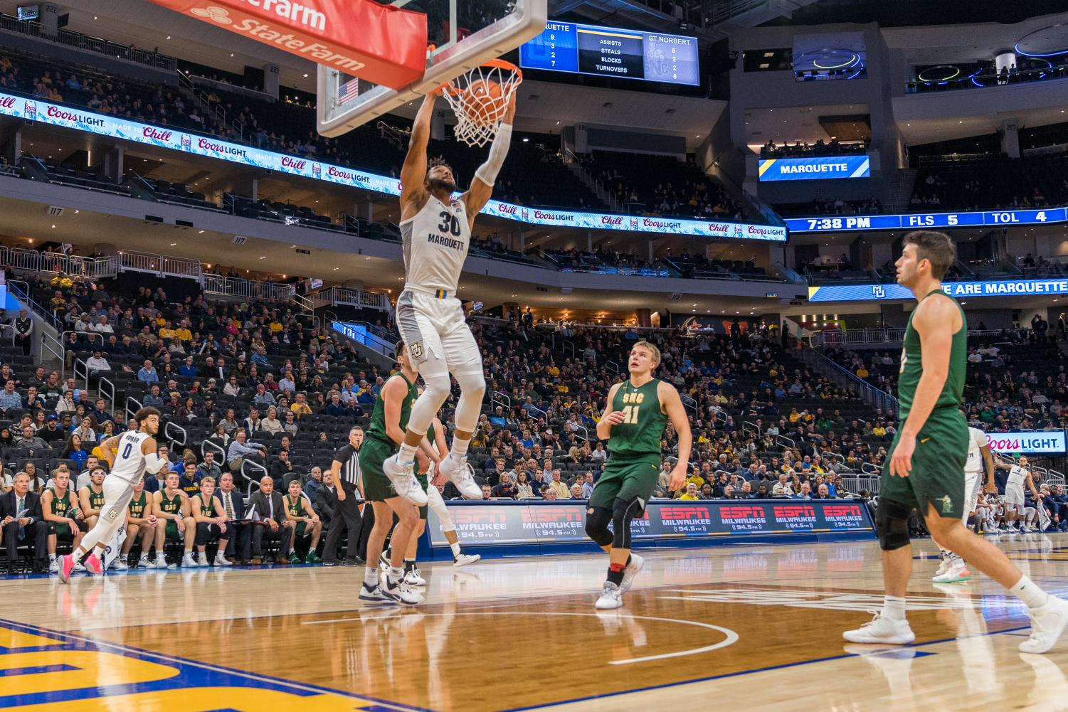 Ed Morrow (30) slam dunks in Marquette's 88-51 win over St. Norbert College.