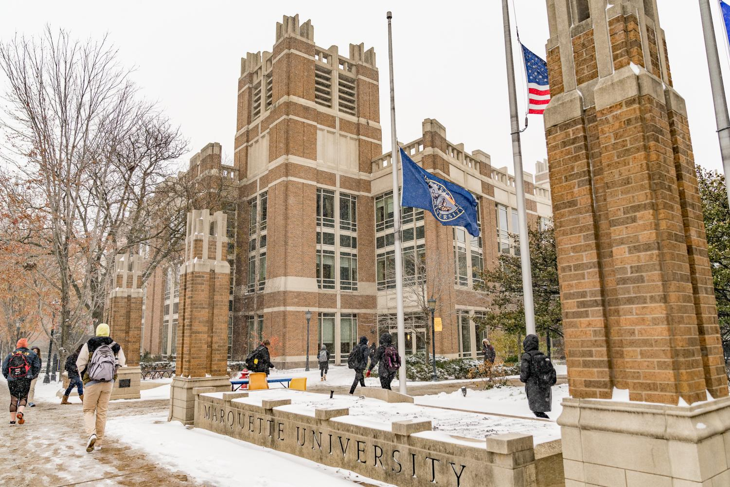 Students navigate through the center of campus in the midst of snowfall. Marquette Wire stock photo.