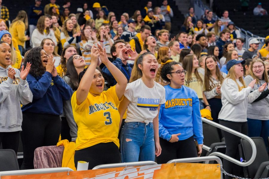 A crowd of students cheers at a men's basketball game at Fiserv Forum.