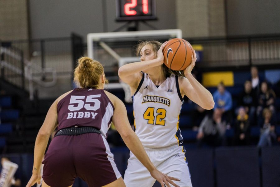 Redshirt junior forward Lauren Van Kleunen holds onto the ball in Marquette's loss to Mississippi State Nov. 25 at the Al McGuire Center.
