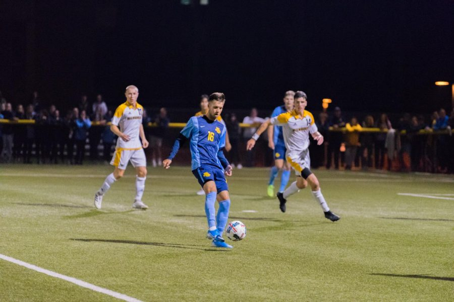 Josh Coan (16) controls the ball in Marquette's 2-1 loss to UW-Milwaukee.