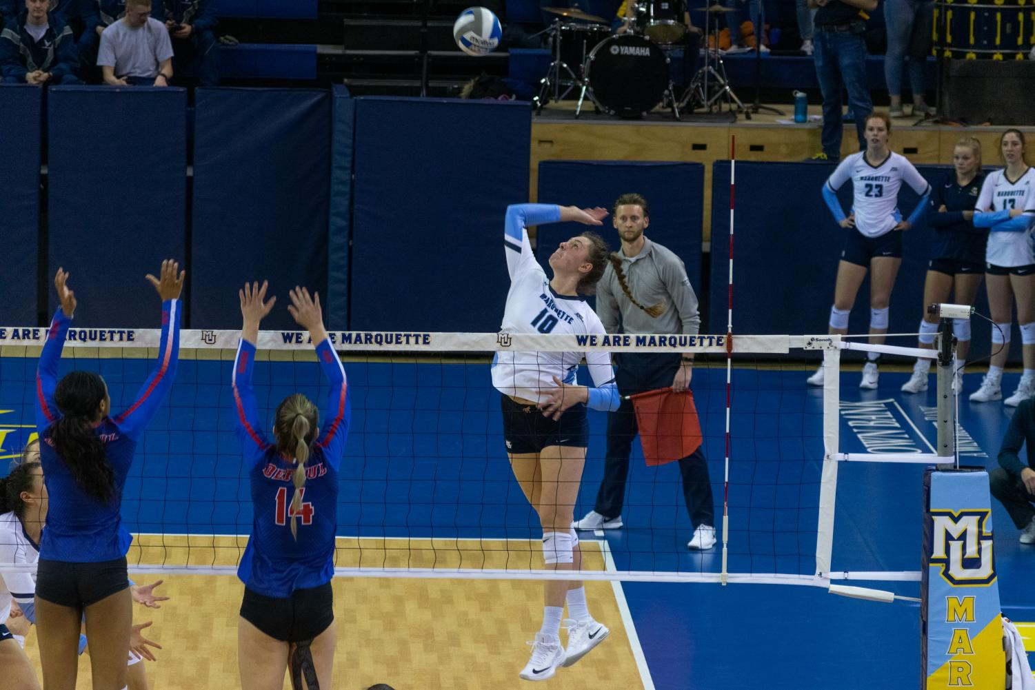 Allie Barber (10) attempts a kill in Marquette's sweep over DePaul Nov. 9 at the Al McGuire Center.