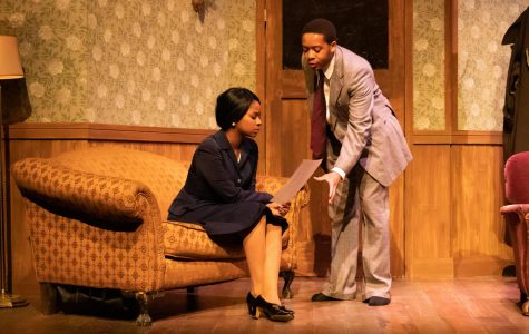 Malaina Moore, senior in the College of Communication playing Lily Ann Green, and Mario Walker, junior in the College of Communication playing Godfrey Crump, act in this production.