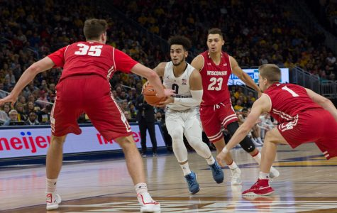 Markus Howard works his way through Wisconsin's defense in MU's 2018 overtime win over the Badgers. (Marquette Wire Stock Photo)