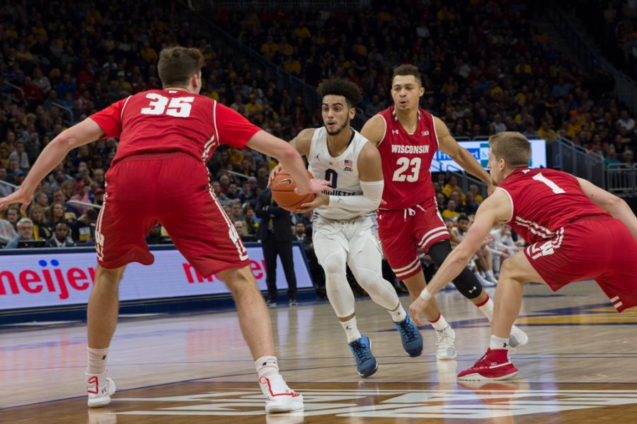Markus+Howard+works+his+way+through+Wisconsin%27s+defense+in+MU%27s+2018+overtime+win+over+the+Badgers.+%28Marquette+Wire+Stock+Photo%29