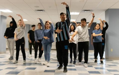 Organization members participating in the event rehearse a dance routine for their upcoming performance. The event will be a fundraiser to enhance the education of children in the Philippines.