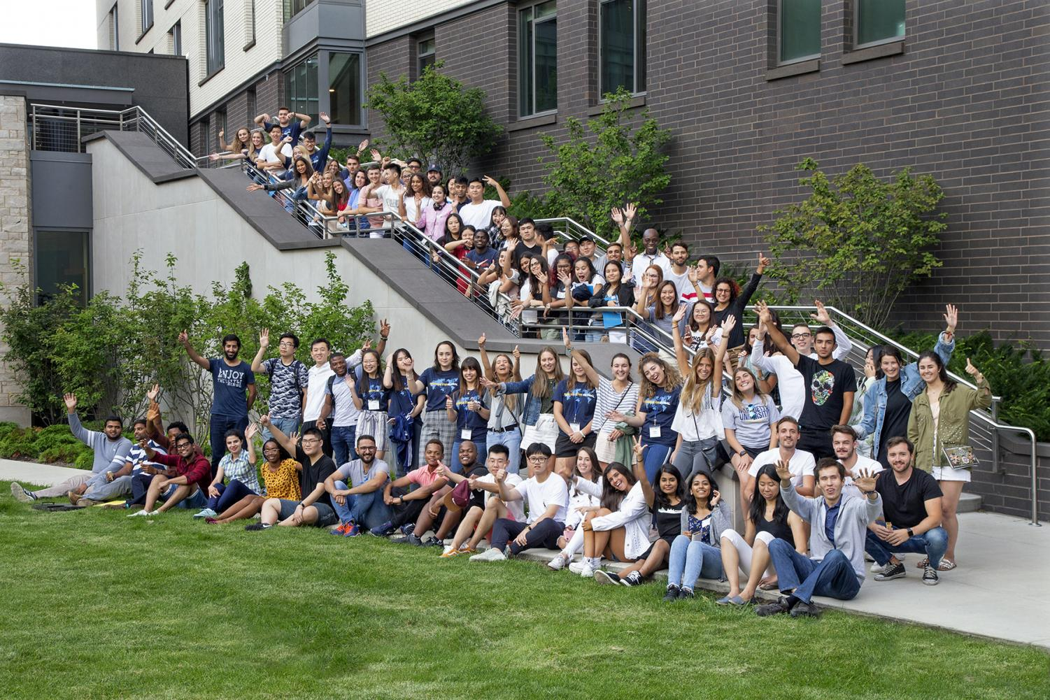 International students stand in front of the Commons before the first week of school begins.