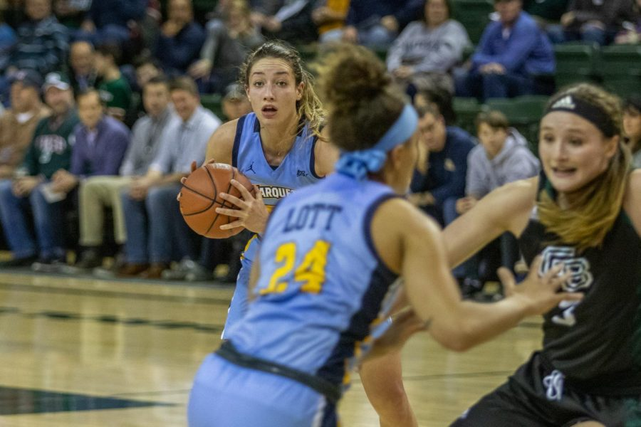 Chloe Marotta looks to pass the ball to teammate Selena Lott in Marquettes 60-47 win over the Green Bay Phoenix.