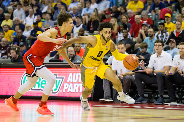 Markus Howard dribbles the ball in Marquette's  73-63 win over Davidson in Orlando. (Photo courtesy of Marquette Athletics.)