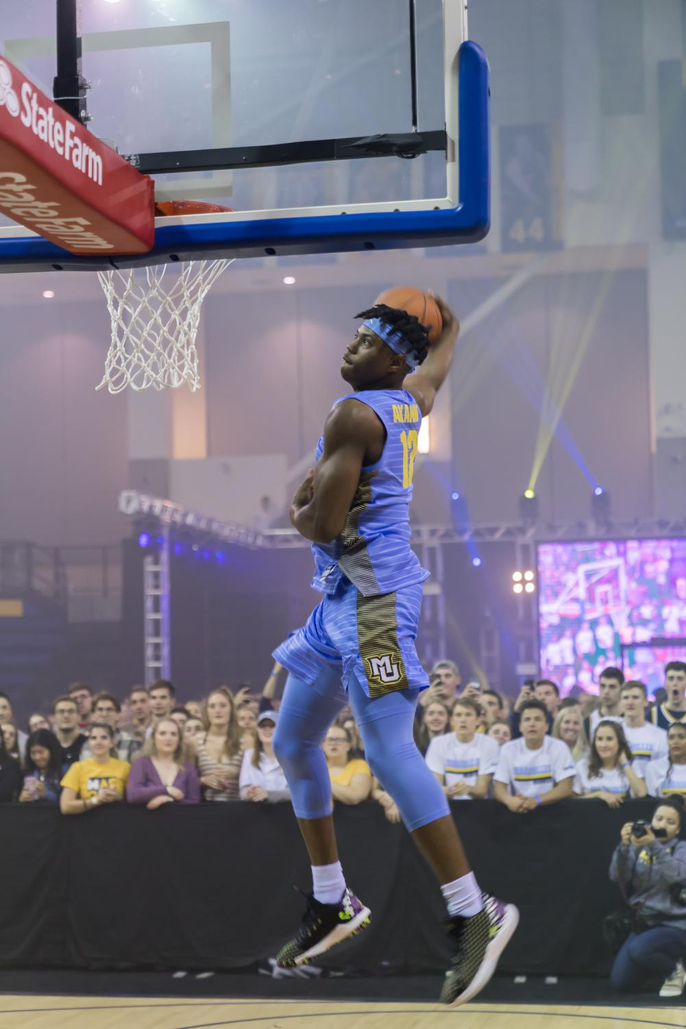 Freshman guard Dexter Akanno competes in the Marquette Madness dunk contest Oct. 4 at the Al McGuire Center.
